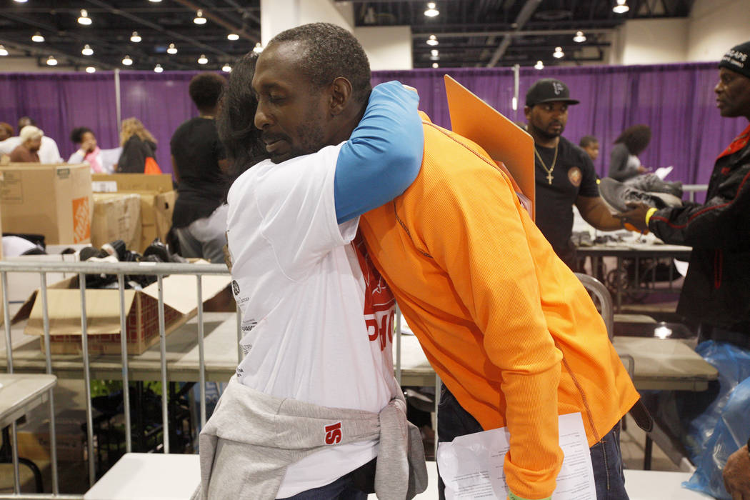 Volunteer Norma Slavish hugs Antoine Phillips at Project Homeless Connect, a service and resource fair for people who are homeless or at-risk at Cashman Center in Las Vegas, Tuesday, Nov. 14, 2017 ...
