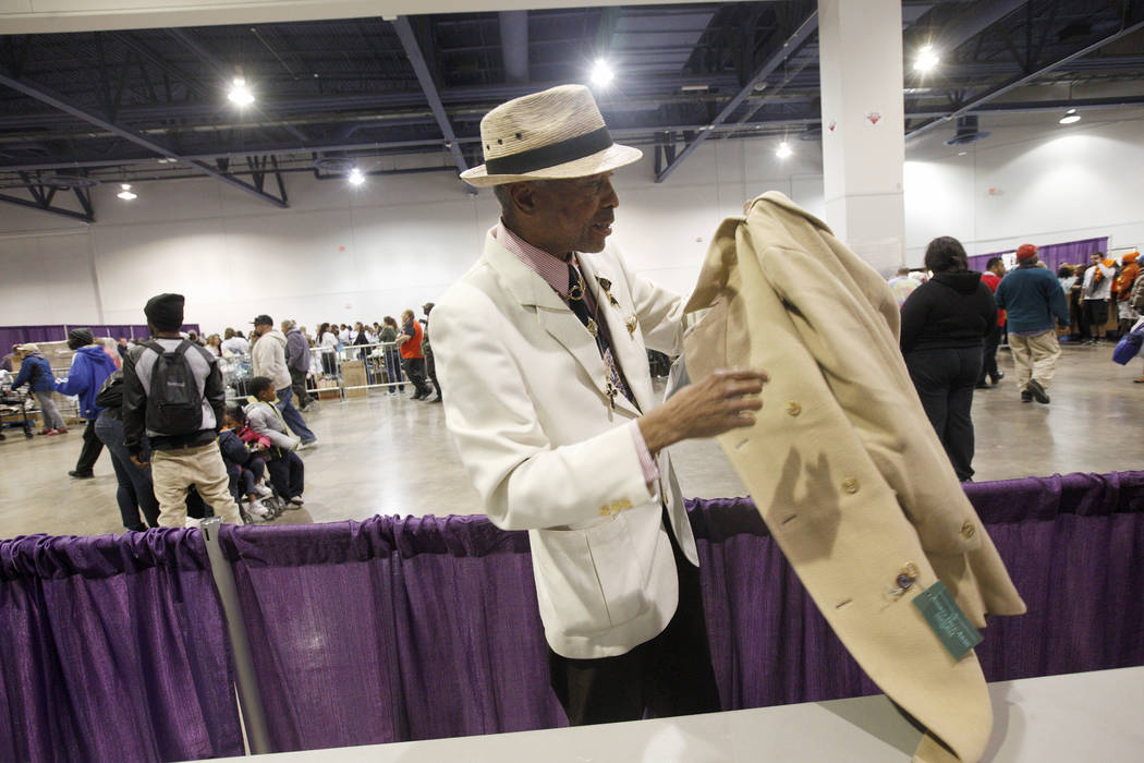 Kevin Washington holds his new coat at Project Homeless Connect, a service and resource fair for people who are homeless or at-risk at Cashman Center in Las Vegas, Tuesday, Nov. 14, 2017. Rachel A ...
