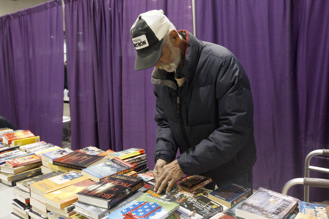 Tom Callaway looks through books at Project Homeless Connect, a service and resource fair for people who are homeless or at-risk at Cashman Center in Las Vegas, Tuesday, Nov. 14, 2017. Rachel Asto ...