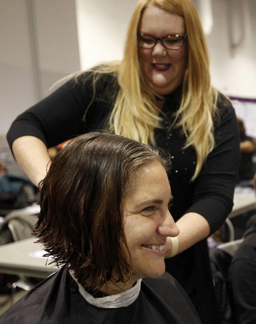 Julia Keogh cuts the hair of Joy Simon at Project Homeless Connect, a service and resource fair for people who are homeless or at-risk at Cashman Center in Las Vegas, Tuesday, Nov. 14, 2017. Rache ...