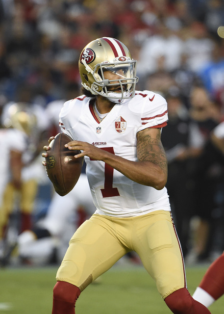 In this Sept. 1, 2016, file photo, San Francisco 49ers quarterback Colin Kaepernick (7) plays during a preseason NFL football game against the San Diego Chargers, in San Diego. (AP Photo/Denis Por ...