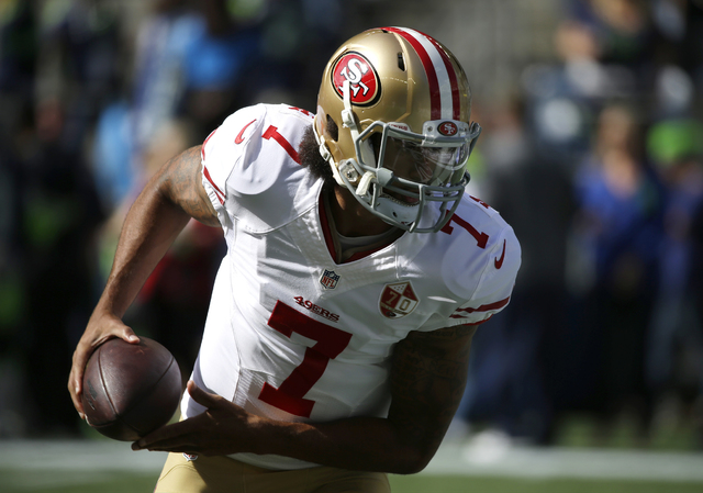 San Francisco 49ers quarterback Colin Kaepernick (7) looks to hand off during warmups before an NFL football game against the Seattle Seahawks, Sunday, Sept. 25, 2016, in Seattle. (AP Photo/Ted S. ...