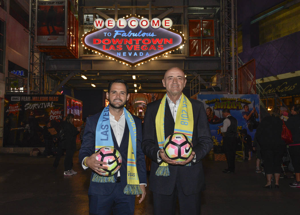 Las Vegas Lights FC coach José Luis Sánchez Solá (right) and son Isidro Sánchez (left), who will work on his staff, are seen on Fremont Street. (Idris Erba/Las Vegas Lights FC)