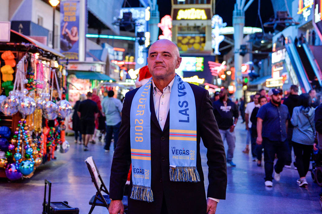 Las Vegas Lights FC coach José Luis Sánchez Solá stands on Fremont Street. (Idris Erba/Las Vegas Lights FC)