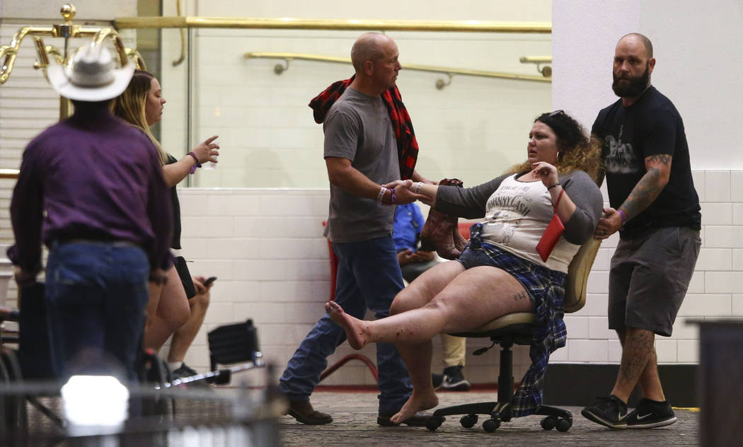 A wounded woman is moved outside of the Tropicana during an active shooter situation. Chase Stevens Las Vegas Review-Journal @csstevensphoto