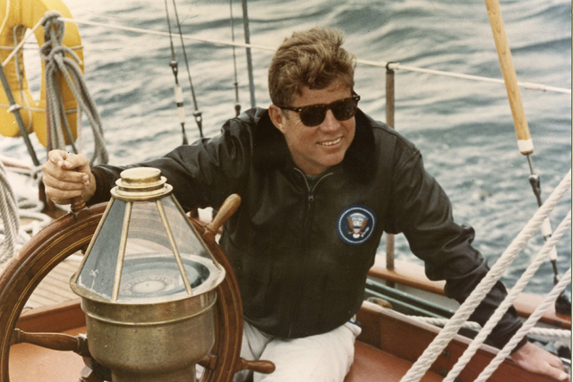 President John F. Kennedy sits onboard the U.S. Coast Guard yacht Manitou off the coast of Maine, Aug. 12, 1962. (Robert Knudsen/The White House/John F. Kennedy Presidential Library/Reuters)