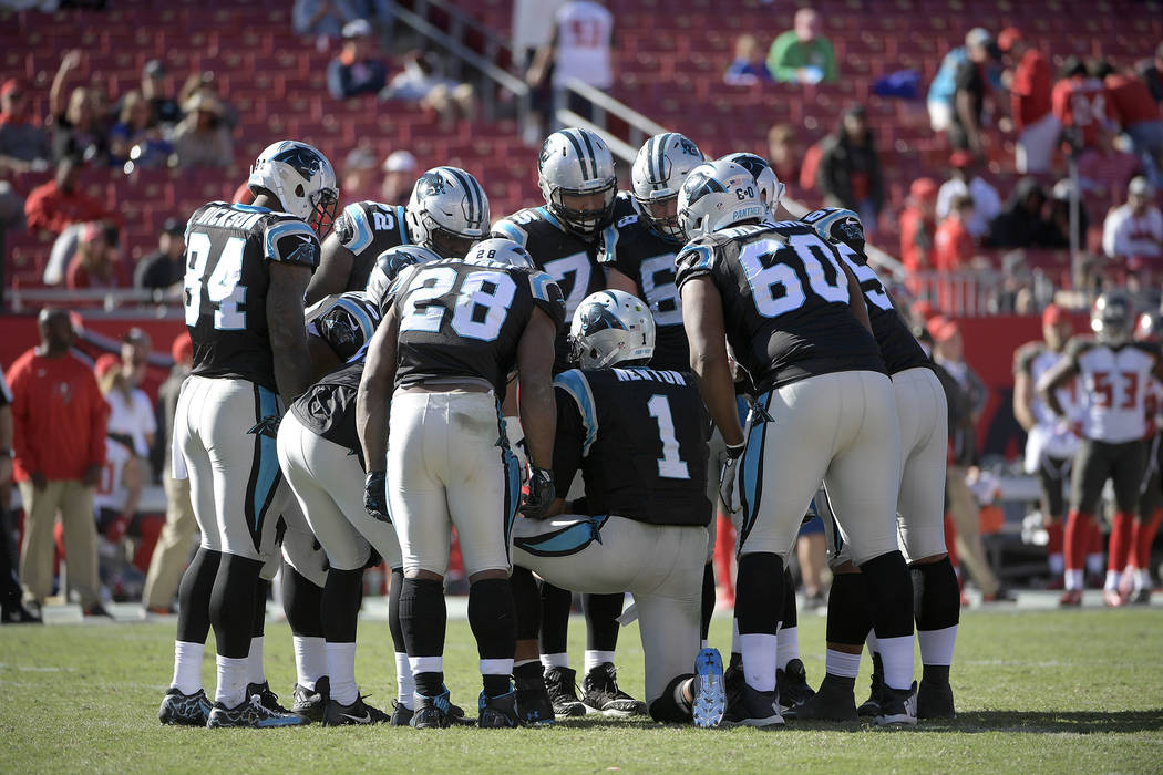 Carolina Panthers quarterback Cam Newton (1) leads a huddle during the second half of an NFL football game against the Tampa Bay Buccaneers Sunday, Oct. 29, 2017, in Tampa, Fla. The Panthers won 1 ...