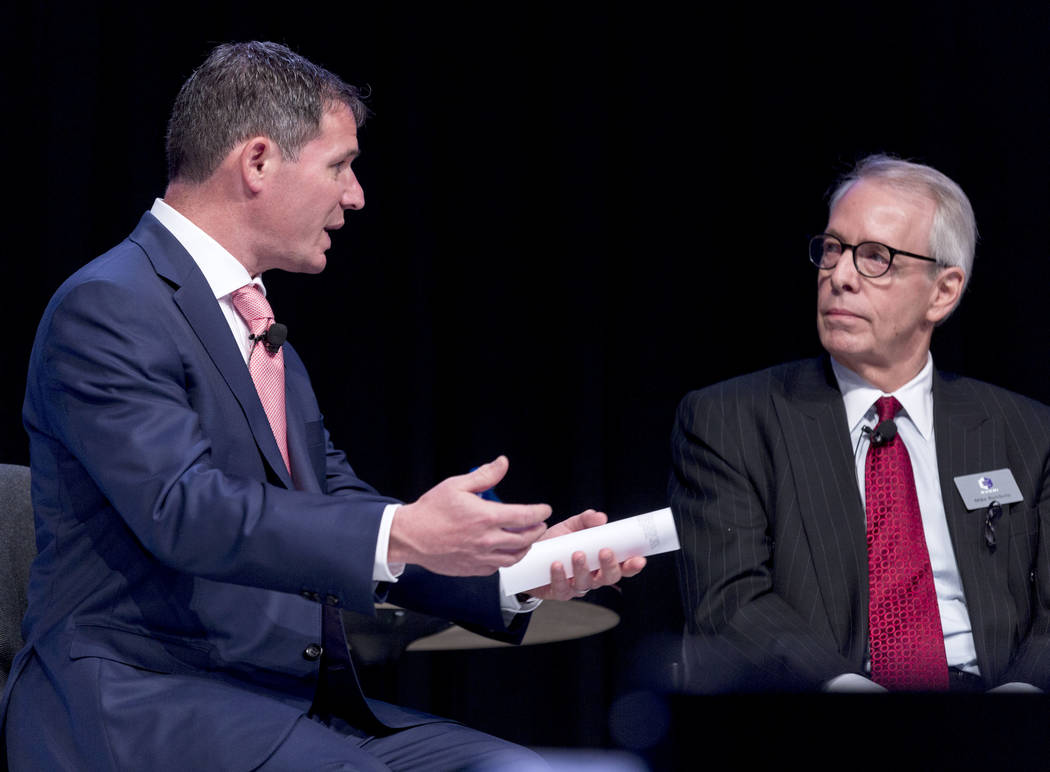 President and CEO of the American Gaming Association Geoff Freeman, left, leads a panel discussion with gaming leaders, including Everi president Michael D. Rumbolz, at the Special Events Stage at ...