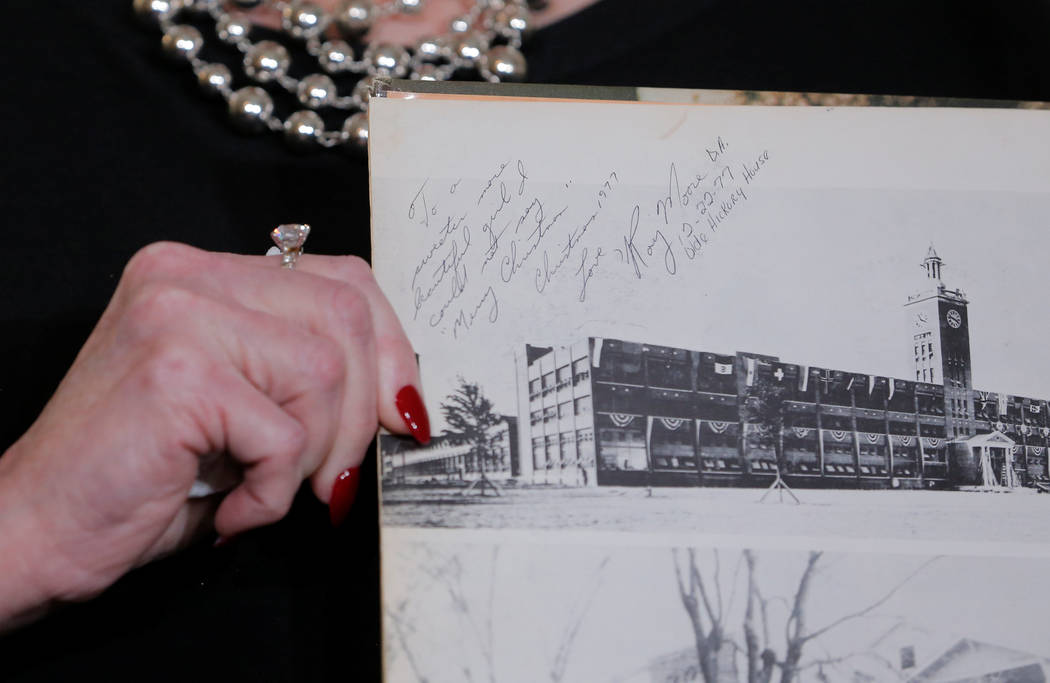 Beverly Nelson shows a school year book with attorney Gloria Allread signed by Roy Moore during a news conference announcing new allegations of sexual misconduct against Alabama Republican congres ...