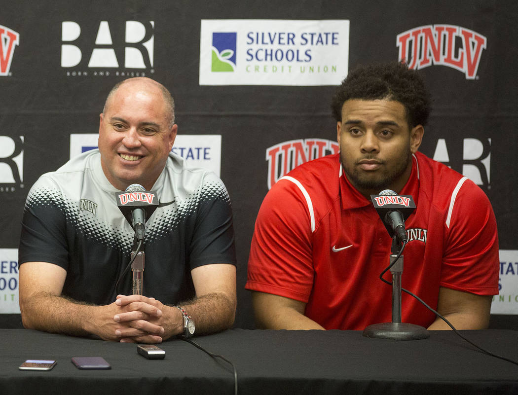 UNLV head coachʔony Sanchez, left, and defensive lineman Mike Hughes Jr.ʤuring a press conference at UNLV's Lied Athletic Complex in Las Vegas on Tuesday, Oct. 31, 2017. Bridget Bennet ...