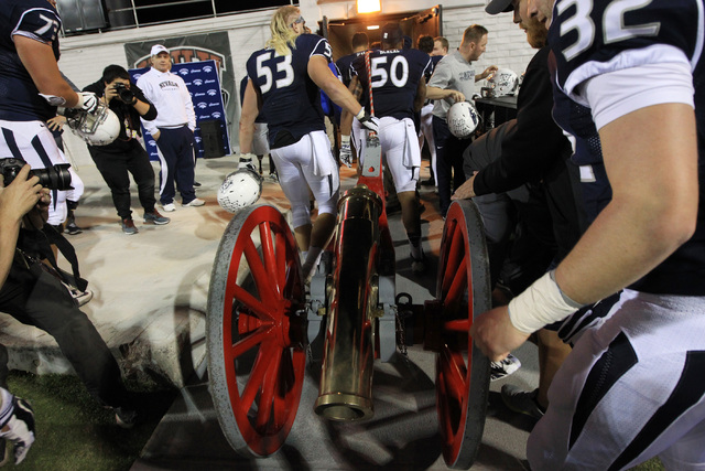 Nevada players take the Fremont Cannon to their locker room after defeating UNLV during their game Saturday, Nov. 29, 2014 at Sam Boyd Stadium. Nevada won 49-27. (Sam Morris/Las Vegas Review-Journal)