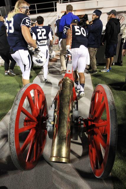 Nevada linebacker Jonathan McNeal hauls the Fremont Cannon to their locker room after their game against UNLV Saturday, Nov. 29, 2014 at Sam Boyd Stadium. Nevada won 49-27. (Sam Morris/Las Vegas R ...