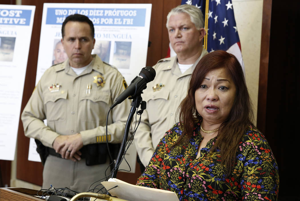 Noema Gonzalez, mother of murder victim Sherryl Sacueza, speaks as assistant Sheriffs Tom Roberts, left, looks on during a press conference where the FBI announced the addition of Jesus Roberto Mu ...