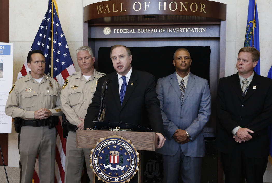 """Aaron C. Rouse, special agent for the FBI in Nevada, speaks during a press conference announcing the addition of Jesus Roberto Munguia to the FBI's """"Ten Most Wanted Fugitives"""" li ..."""