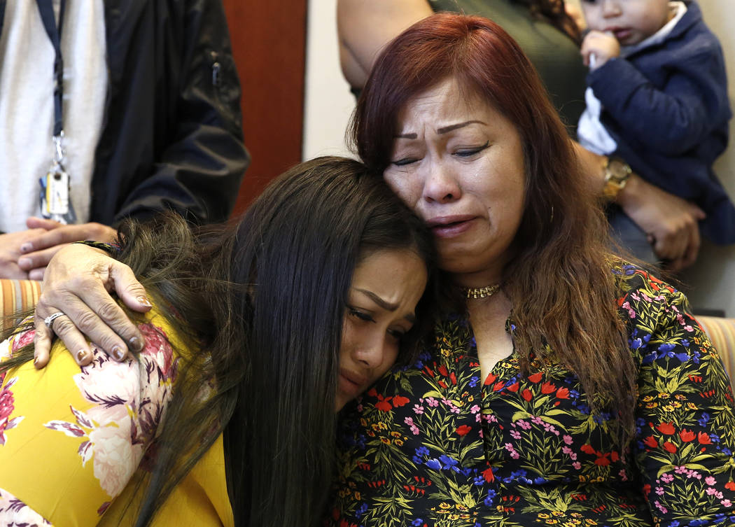Noema Gonzalez, mother of murder victim Sherryl Sacueza, right, hugs her granddaughter Dysabel Munguia, 21, at a press conference after the FBI announced the addition of Jesus Roberto Munguia to t ...