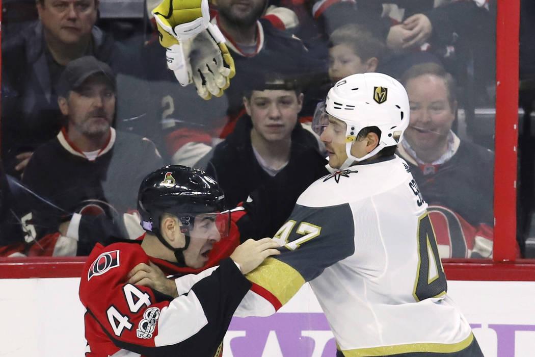 Vegas Golden Knights defenseman Luca Sbisa (47) fights Ottawa Senators center Jean-Gabriel Pageau (44) during the first period of an NHL hockey game, Saturday, Nov. 4, 2017 in Ottawa, Ontario. (Fr ...