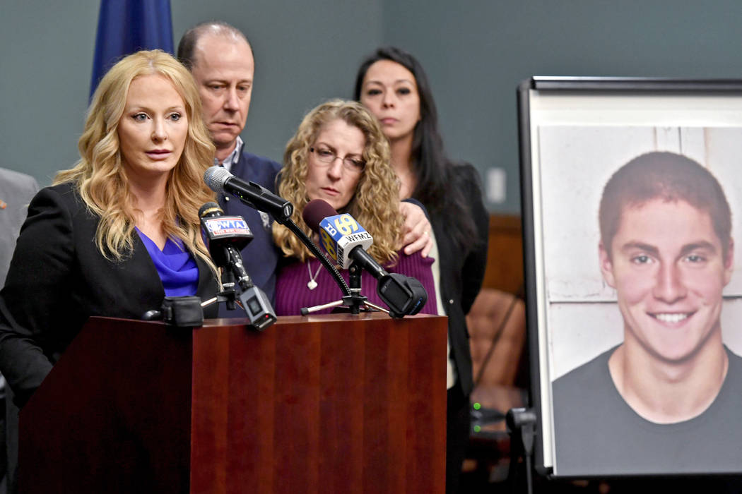 Centre County, Pa., District Attorney Stacy Parks Miller, left, announces findings an investigation into the death of Penn State University fraternity pledge Tim Piazza, seen in photo at right, as ...