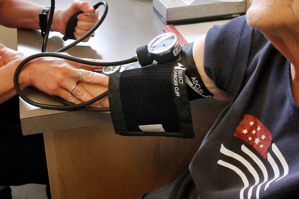 In this June 6, 2013, file photo, a patient has her blood pressure checked by a registered nurse in Plainfield, Vt. New medical guidelines announced Monday, Nov. 13, 2017, lower the threshold for  ...