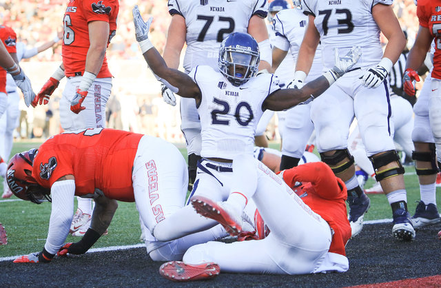 Nevada Wolf Pack running back James Butler (20) reacts to scoring a touchdown during the UNLV Nevada football game at Sam Boyd Stadium in Las Vegas on Saturday, Nov. 26, 2016. Nevada won 45-10. Br ...