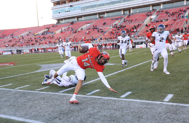 UNLV Rebels quarterback Kurt Palandech (14) is pushed out of bounds during the UNLV Nevada football game at Sam Boyd Stadium in Las Vegas on Saturday, Nov. 26, 2016. Brett Le Blanc/Las Vegas Revie ...