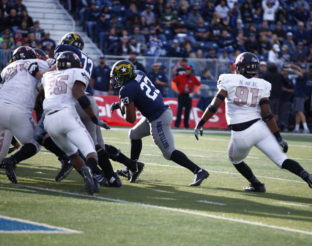 Nevada Wolf Pack running back Kelton Moore (23) heads for the end zone against the UNLV Rebels during the second half of their game in Reno, Saturday, Nov. 25, 2017. Heidi Fang Las Vegas Review-Jo ...