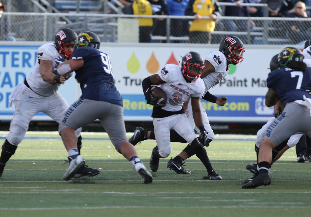 UNLV Rebels running back Lexington Thomas (3) runs with the football against the Nevada Wolf Pack during the first half of their game in Reno, Saturday, Nov. 25, 2017. Heidi Fang Las Vegas Review- ...