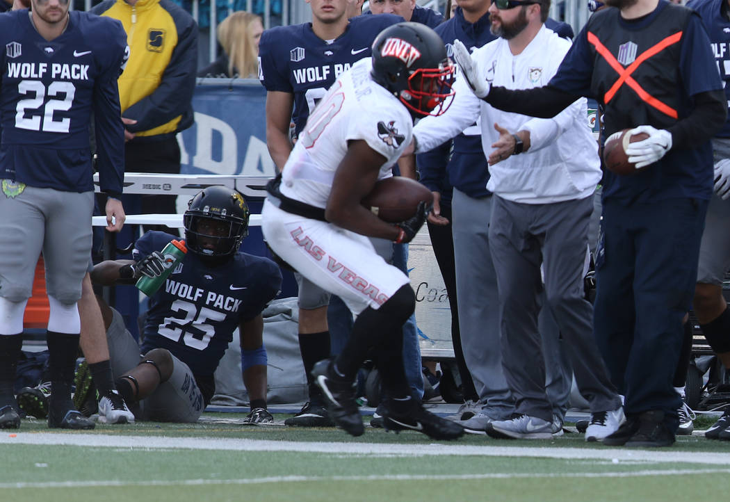 UNLV Rebels wide receiver Darren Woods Jr. (10) makes a catch against the Nevada Wolf Pack during the first half of their game in Reno, Saturday, Nov. 25, 2017. Heidi Fang Las Vegas Review-Journal ...