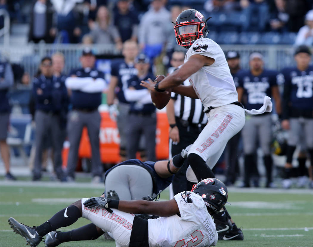 UNLV Rebels quarterback Armani Rogers (1) stands up in the pocket and avoids a tackle during the first half of their game against the Nevada Wolf Pack in Reno, Saturday, Nov. 25, 2017. Heidi Fang  ...