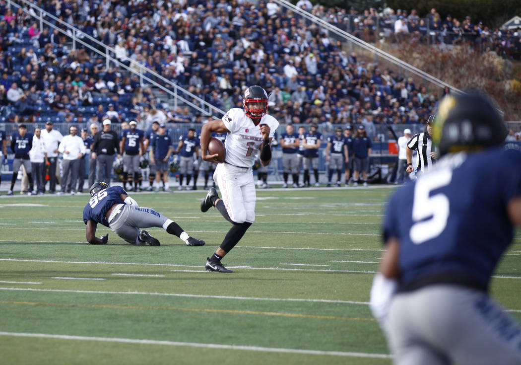 UNLV Rebels quarterback Armani Rogers (1) runs with the football during the first half of their game against the Nevada Wolf Pack in Reno Saturday, Nov. 25, 2017. Heidi Fang Las Vegas Review-Journ ...