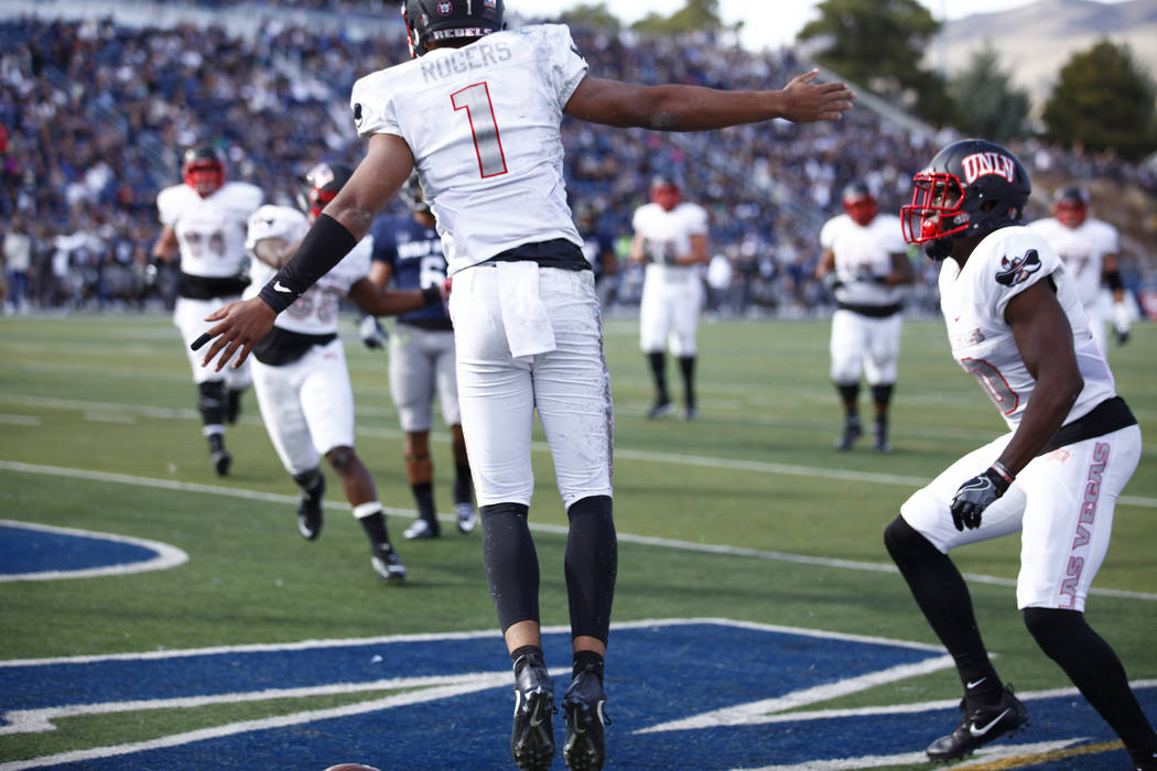 UNLV Rebels quarterback Armani Rogers (1) celebrates scoring a touchdown during the first half of their game against the Nevada Wolf Pack in Reno Saturday, Nov. 25, 2017. Heidi Fang Las Vegas Revi ...