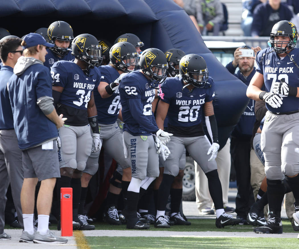 Nevada Wolf Pack linebacker Travis Wilson (34), defensive back Jimbo Davis (22) and defensive back Ryan Mack (20) prepare to lead the team on to the field before their game against the UNLV Rebels ...