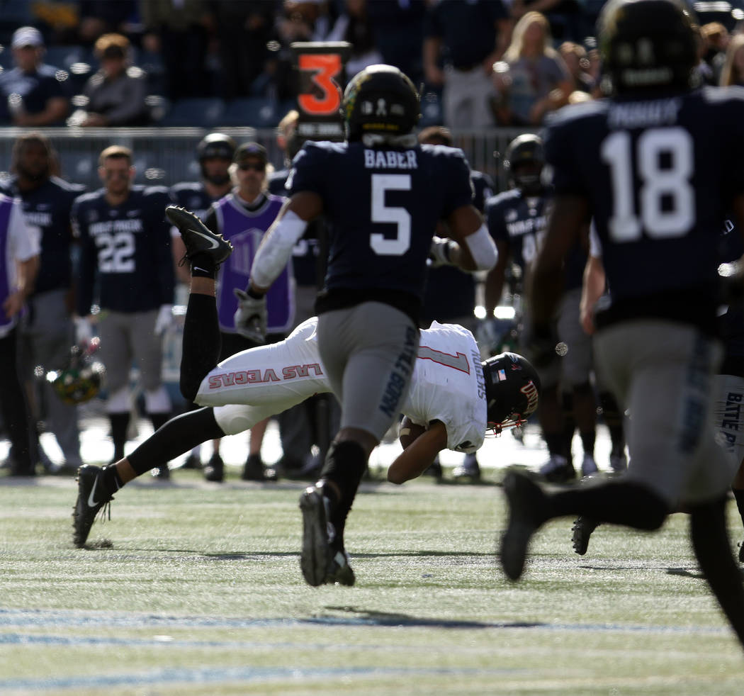 UNLV Rebels quarterback Armani Rogers (1) carries the football against the Nevada Wolf Pack during the first half of their game in Reno Saturday, Nov. 25, 2017. Heidi Fang Las Vegas Review-Journal ...