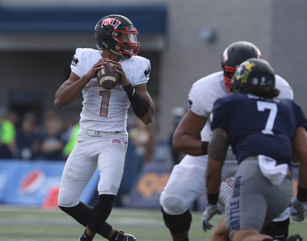 UNLV Rebels quarterback Armani Rogers (1) prepares to throw the football during the first half of their game against the Nevada Wolf Pack in Reno, Saturday, Nov. 25, 2017. Heidi Fang Las Vegas Rev ...