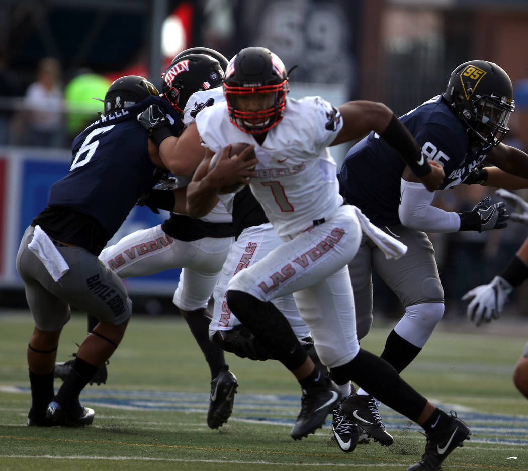 UNLV Rebels quarterback Armani Rogers (1) runs with the football during the first half of their game against the Nevada Wolf Pack in Reno, Saturday, Nov. 25, 2017. Heidi Fang Las Vegas Review-Jour ...