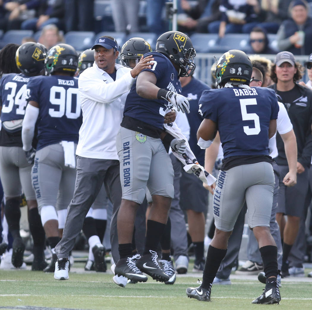 Nevada Wolf Pack linebacker Lawson Hall (30) celebrates on the sideline after recovering a fumble during the first half of their game in Reno, Saturday, Nov. 25, 2017. Heidi Fang Las Vegas Review- ...