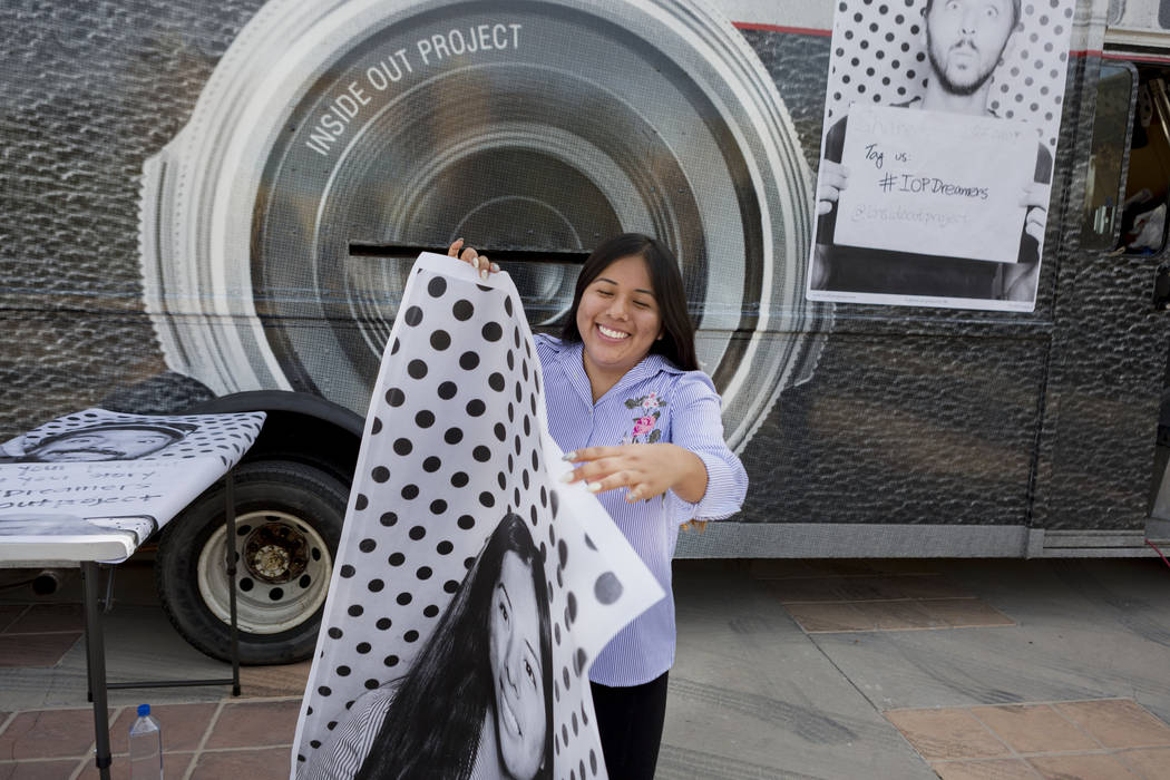Michelle Martin, 20, holds a large print of herself that will be pasted apart of the Inside Out Project for Dreamers at the East Las Vegas Community Center in Las Vegas, Monday, Nov. 13, 2017. Eli ...