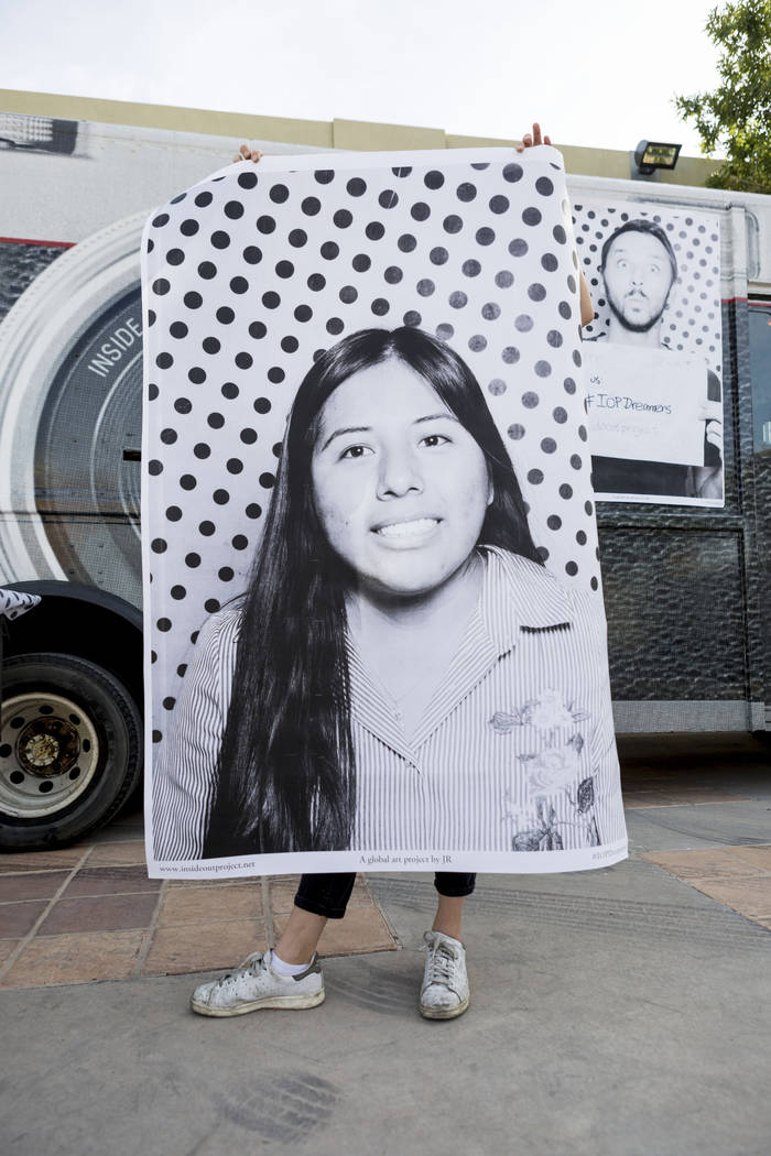 A print of Michelle Martin, 20, is held outside of the Inside Out Project truck at an event for DACA recipients, Dreamers, at the East Las Vegas Community Center in Las Vegas, Monday, Nov. 13, 201 ...