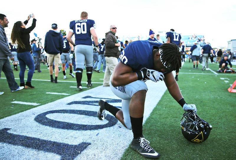 Nov 25, 2017; Reno, NV, USA; Nevada linebacker Lawson Hall (30) takes a knee after Nevada defeated ULNV in the state rivalry game 26-16 at MacKay Stadium. Mandatory Credit: Lance Iversen-USA TODAY ...