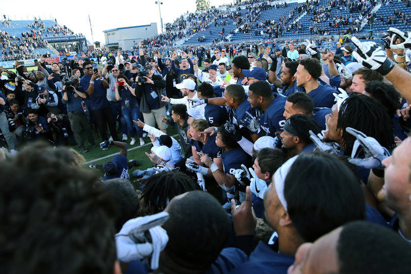 Nov 25, 2017; Reno, NV, USA; Members of the Nevada Wolf Pack football team pose for photos with the Fremont Cannon after they defeated 23-16 at MacKay Stadium. Mandatory Credit: Lance Iversen-USA  ...