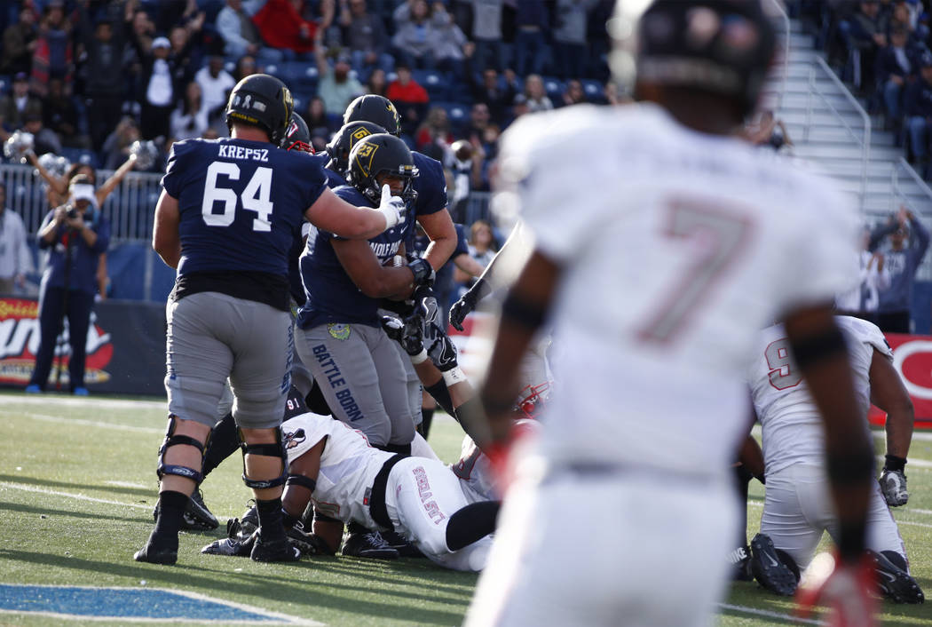 Nevada Wolf Pack running back Kelton Moore (23) scores a touchdown against the UNLV Rebels during the second half of their game in Reno, Saturday, Nov. 25, 2017. Heidi Fang Las Vegas Review-Journa ...