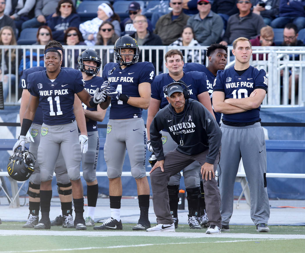 Nevada Wolf Pack head coach Jay Norvell coaches from the sideline as his players look on during the second half of their game against the UNLV Rebels in Reno, Saturday, Nov. 25, 2017. Heidi Fang L ...