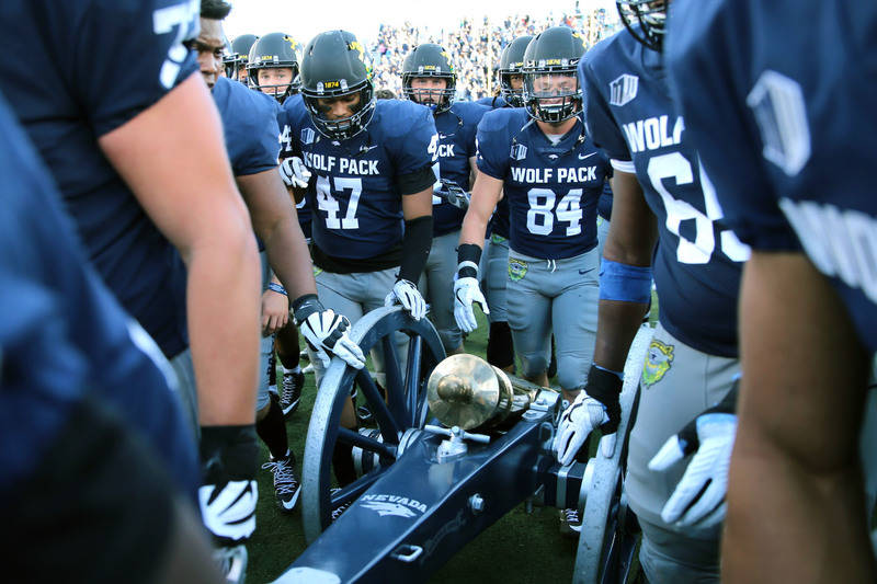 Nov 25, 2017; Reno, NV, USA; Members of the Nevada Wolf Pack football team pull the Fremont Cannon onto the field after they defeated 23-16 at MacKay Stadium. Mandatory Credit: Lance Iversen-USA T ...