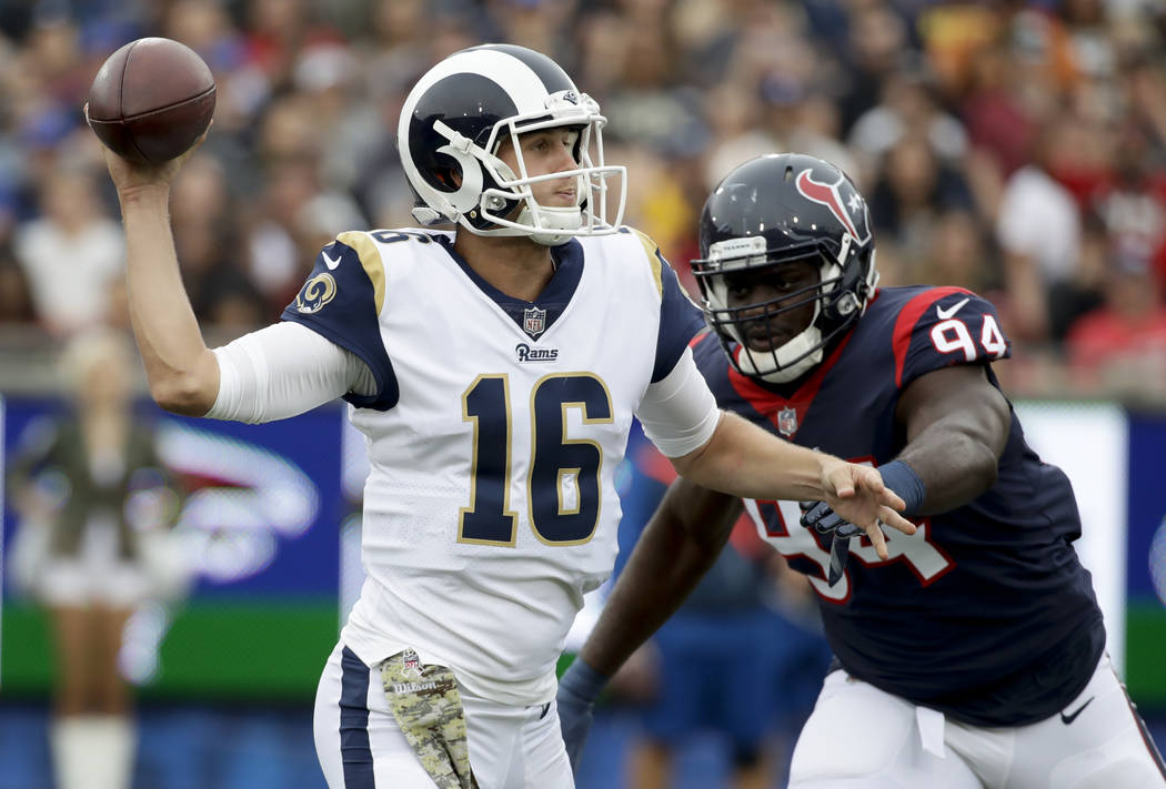 Los Angeles Rams quarterback Jared Goff passes under pressure form Houston Texans linebacker Ufomba Kamalu during the first half of an NFL football game Sunday, Nov. 12, 2017, in Los Angeles. (AP  ...