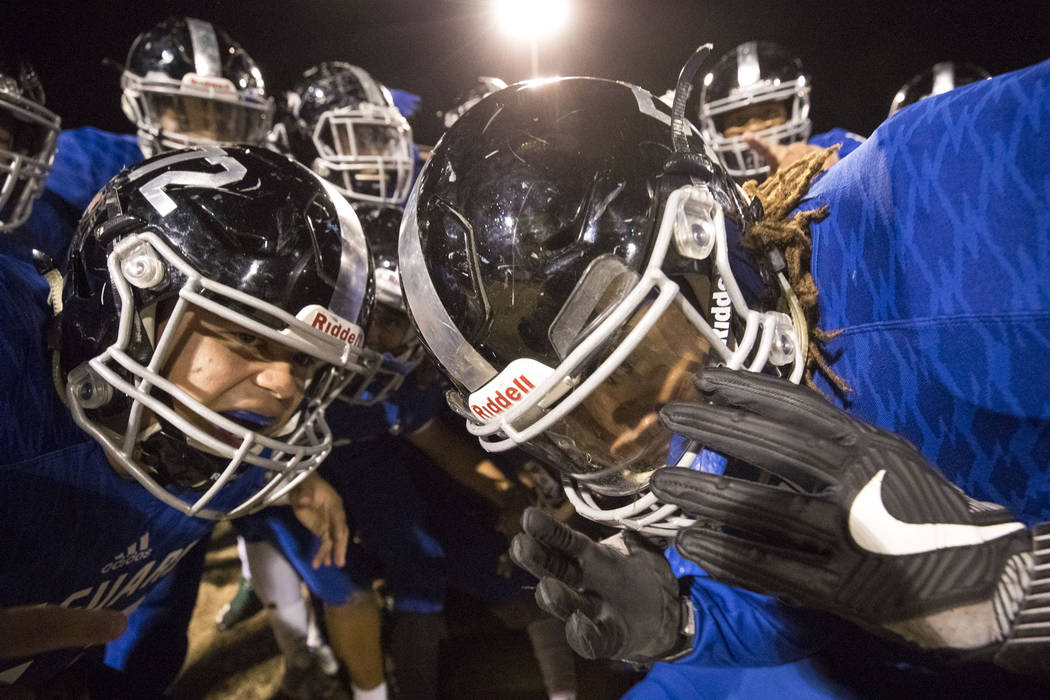 Desert Pines players celebrate their 48-0 victory over Sunrise Mountain High School following a Class 3A state quarterfinal football game at Desert Pine High School in Las Vegas, Thursday, Nov. 9, ...