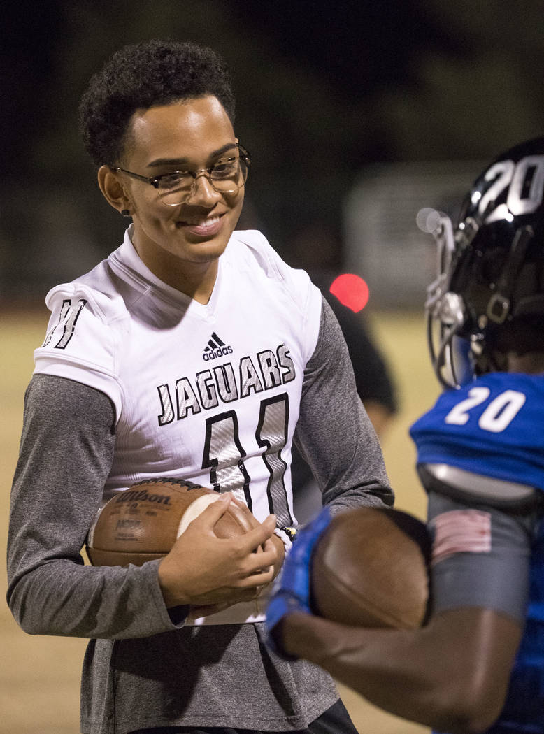 Desert Pines sophomore Kaleb Ramsey (11) talks with teammate Zontrail Brinson (20) during the Class 3A state quarterfinal football game at Desert Pine High School in Las Vegas, Thursday, Nov. 9, 2 ...