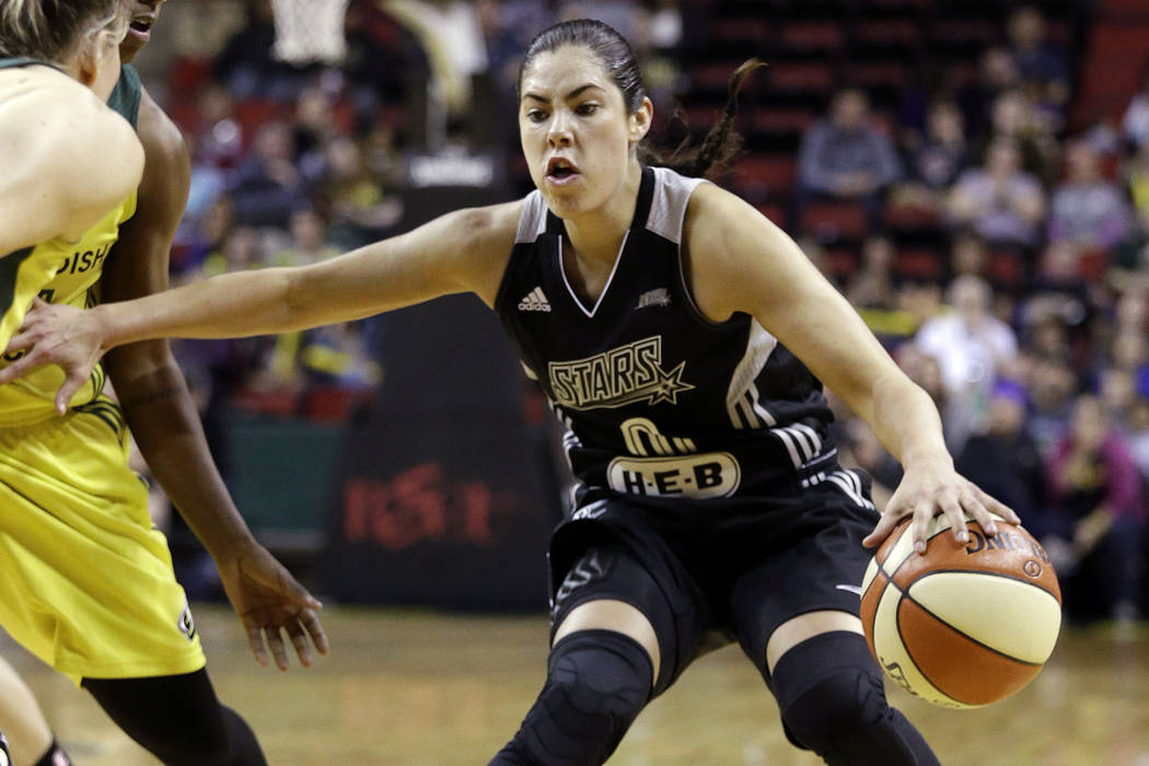 San Antonio Stars' Kelsey Plum drives against the Seattle Storm in the first half of a WNBA basketball game Sunday, June 18, 2017, in Seattle. (AP Photo/Elaine Thompson)