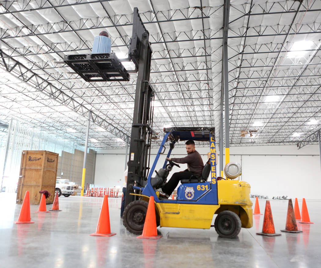 Teamsters training center seen to alleviate worker shortage las apprentice jeremy estrada participates in a drill during an advanced forklift class at the new southern 1betcityfo Images