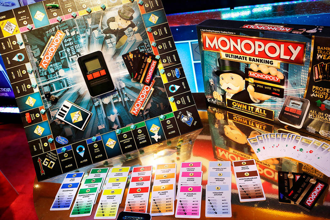 In this Monday, Feb. 15, 2016, file photo, the Monopoly Ultimate Banking Game from Hasbro is displayed at Toy Fair in New York. Shares of Mattel soared in after-hours trading Friday, Nov. 10, 2017 ...
