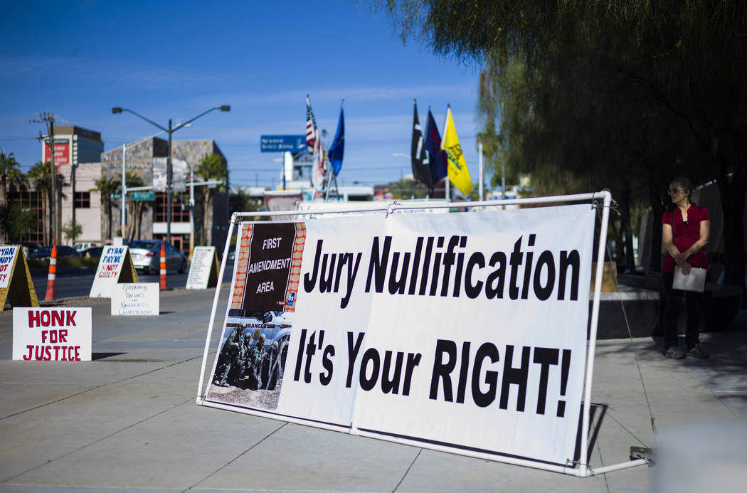 Signs placed in support of the Bundy family and others outside the in Lloyd George U.S. Courthouse in downtown Las Vegas on Tuesday, Nov. 14, 2017. Opening statements were delivered in the trial f ...
