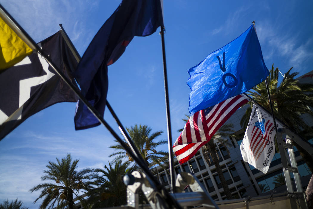Flags placed in support of the Bundy family and others outside the in Lloyd George U.S. Courthouse in downtown Las Vegas on Tuesday, Nov. 14, 2017. Opening statements were delivered in the trial f ...